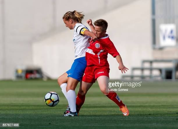 Anita Pinczi of MTK Hungaria FC competes for the ball with Qendresa Bajra of WFC Hajvalia during the UEFA Women's Champions League Qualifying match...