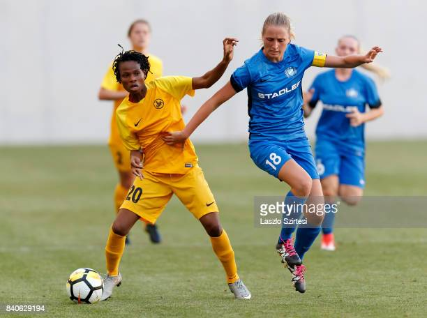 Anita Pinczi of MTK Hungaria FC fights for the ball with Charity Adule of WFC BIIKKazygurt during the UEFA Women's Champions League Qualifying match...