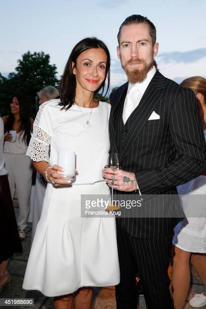 Anita Tillmann and Justin O'Shea attend the Burda Style Cocktail on July 10 2014 in Berlin Germany