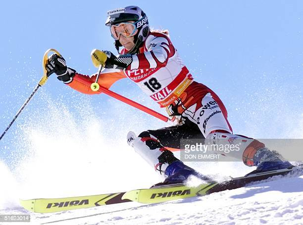 Anita Wachter of Austria hits a gate during the first run in the Women's Slalom 13 February during the 1999 World Alpine Ski Championships in Vail...