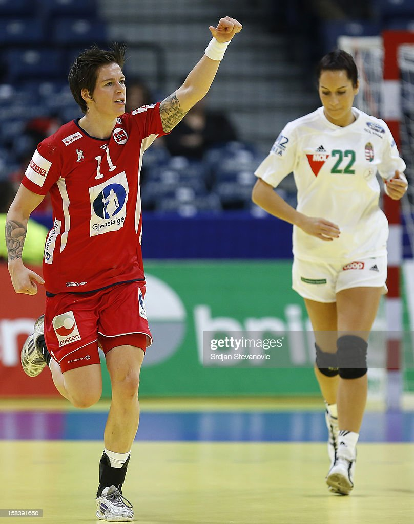 Anja Edin (L) of Norway celebrates the goal near Bernadett Bodi (R) of Hungary during the Women's European Handball Championship 2012 semifinal match between Norway and Hungary at Arena Hall on December 15, 2012 in Belgrade, Serbia.