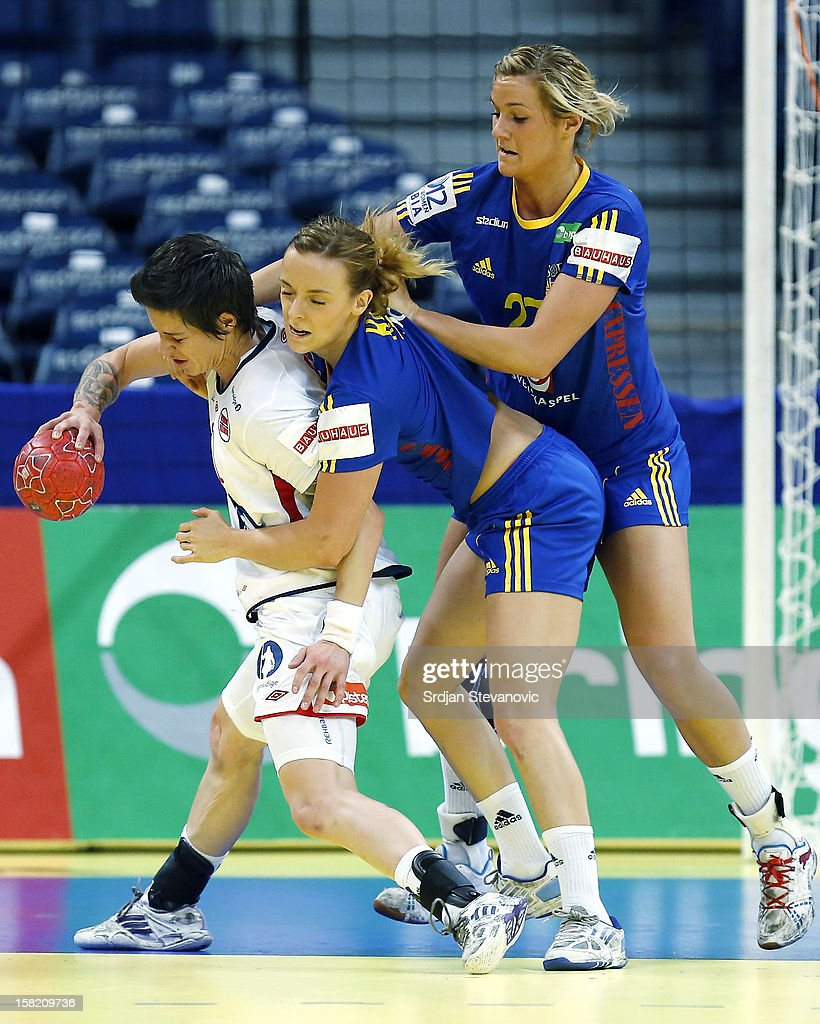 Anja Edin (L) of Norway is challenged by Isabelle Gullden (R) of Sweden during the Women's European Handball Championship 2012 Group I main round match between Norway and Sweden at Arena Hall on December 11, 2012 in Belgrade, Serbia.