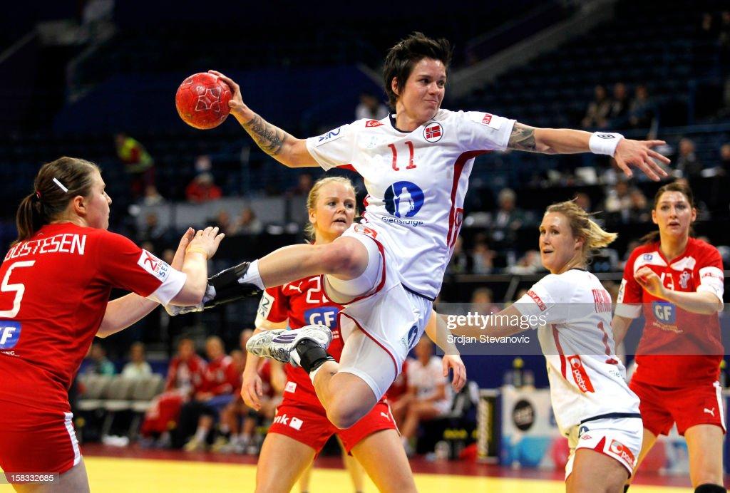Anja Edin of Norway scores the goal near Mie Augustsen of Denmark during the Women's European Handball Championship 2012 Group I main round match...