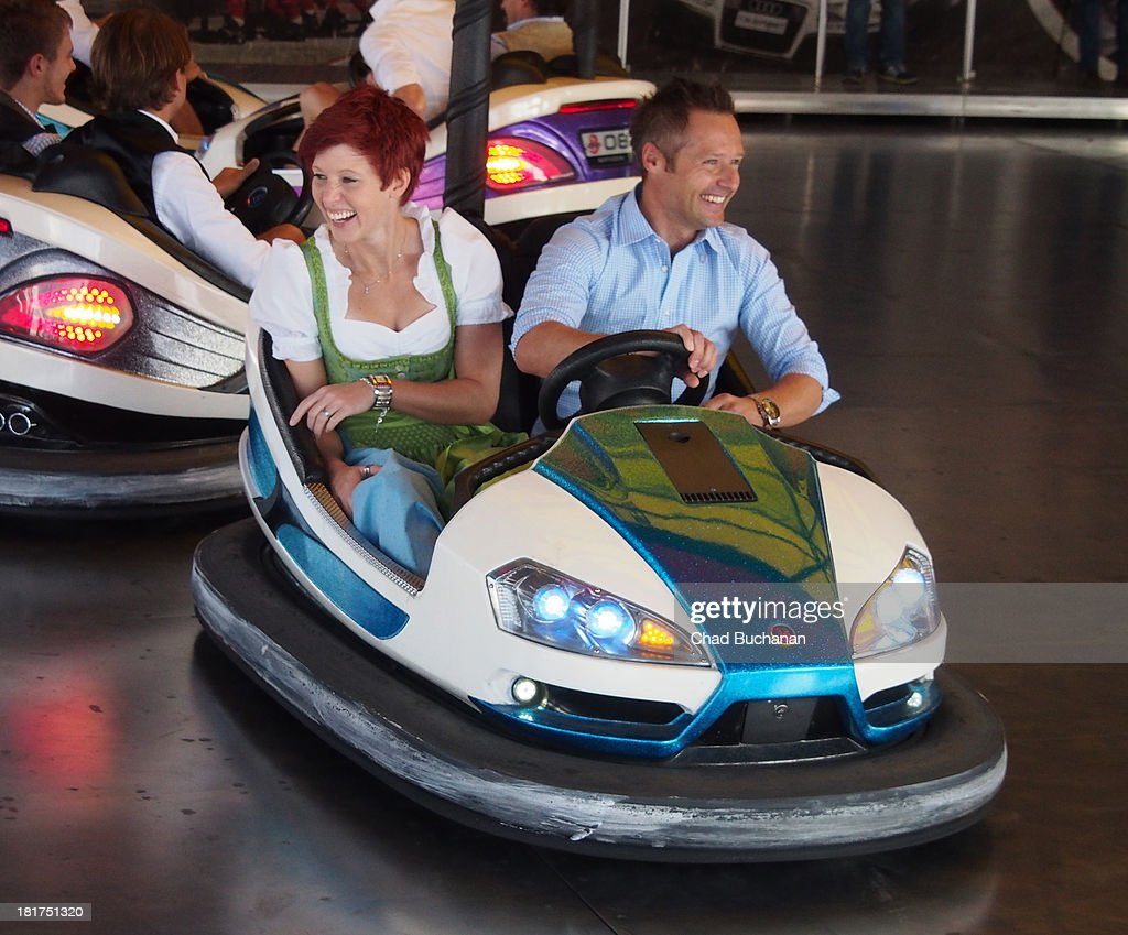 <a gi-track='captionPersonalityLinkClicked' href=/galleries/search?phrase=Anja+Huber&family=editorial&specificpeople=724605 ng-click='$event.stopPropagation()'>Anja Huber</a> and Andy Priaulx sighting at Theresienwiese on September 24, 2013 in Munich, Germany.