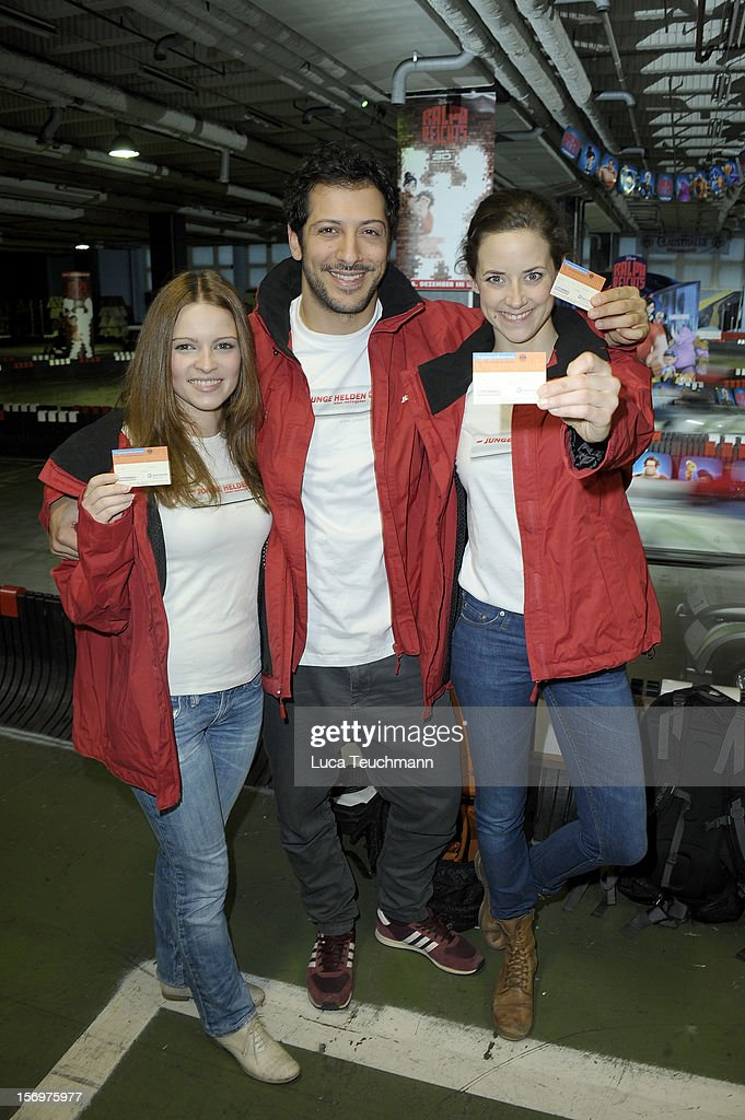 Anja Knauer; Fahri Yardim and Jennifer Ulrich attend the photocall 'Wreckin Ralph' on November 26, 2012 in Berlin, Germany.