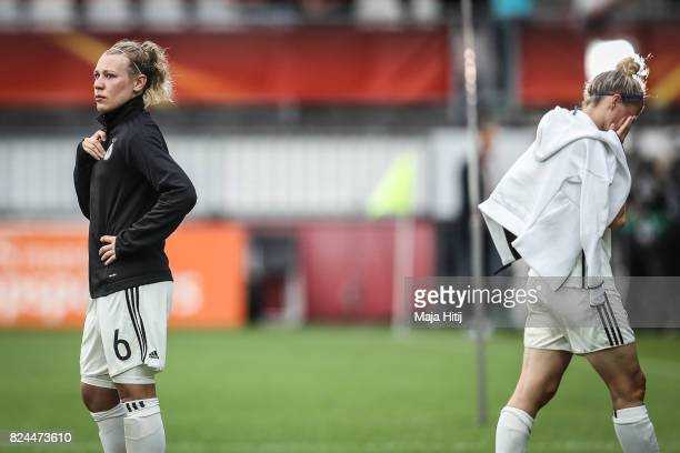 Anja Mittag and Kristin Demann of Germany react after the UEFA Women's Euro 2017 Quarter Final match between Germany and Denmark at Sparta Stadion on...