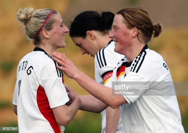 Anja Mittag and Melanie Behringer of Germany celebrate their team's first goal during the Woman's Algarve Cup match between Germany and Denmark at...