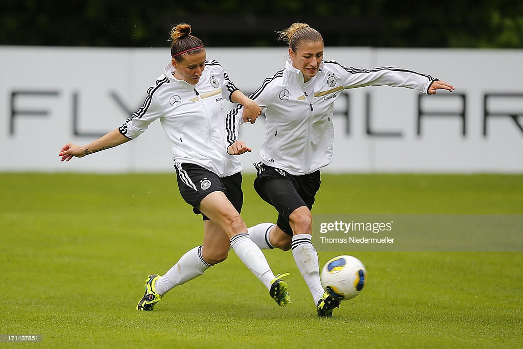 Anja Mittag (L) fights for the ball with Bianca Schmidt (R) during the German women's national team training session at HVB Club Sportzentrum on June 24, 2013 in Munich, Germany.