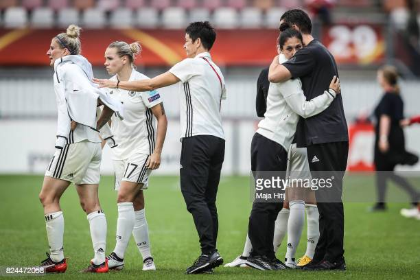 Anja Mittag Isabel Kerschowski and Sara Doorsoun of Germany react after the UEFA Women's Euro 2017 Quarter Final match between Germany and Denmark at...