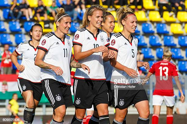 Anja Mittag Lena Petermann and Kristin Demann of Germany celebrate after scoring during the UEFA Women's Euro 2017 Qualifier between Hungary and...