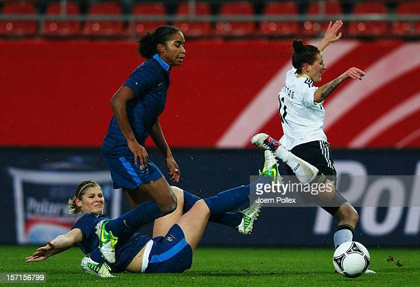 Anja Mittag of Germany and Camille Abily of France compete for the ball during the Women's International Friendly match between Germany and France...