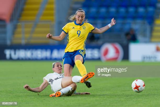 Anja Mittag of Germany and Kosovare Asllani of Sweden battle for the ball l during the Group B match between Germany and Sweden during the UEFA...
