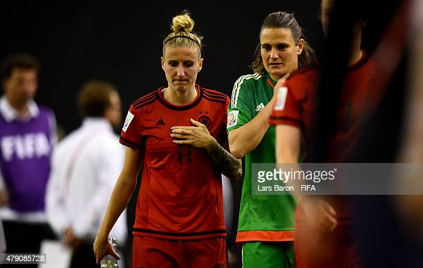 Anja Mittag of Germany and Nadine Angerer of Germany are looking dejected after loosing the FIFA Women's World Cup 2015 Semi Final match between USA...