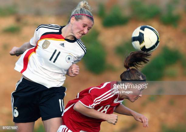 Anja Mittag of Germany and Theresa Nielson of Denmark battle for the ball during the Woman's Algarve Cup match between Germany and Denmark at the...