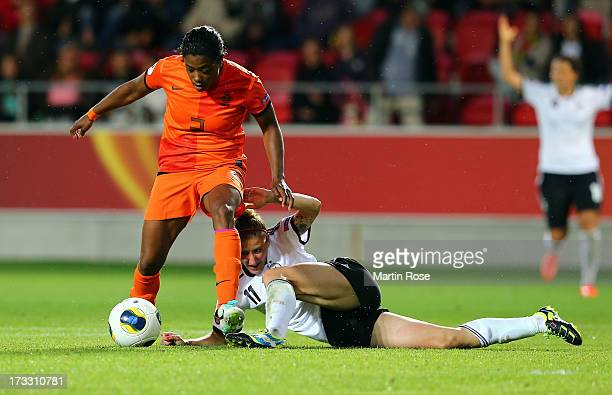 Anja Mittag of Germany battles for the ball with Dyanne Bito of Netherlands during the UEFA Women's Euro 2013 group B match at Vaxjo Arena on July 11...