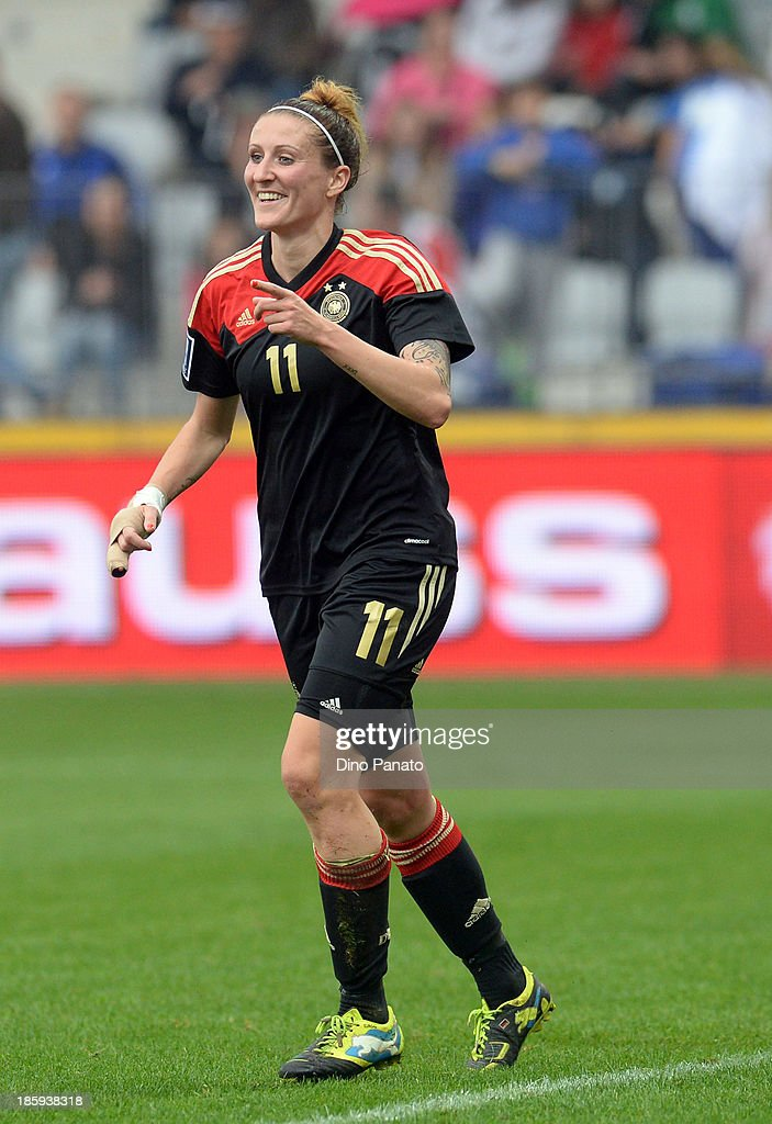Anja Mittag #11 of Germany celebrates after scoring during the Qualifying Round - FIFA Women's World Cup between Slovenia and Germany at SRC Bonifika stadio on October 26, 2013 in Koper, Slovenia.