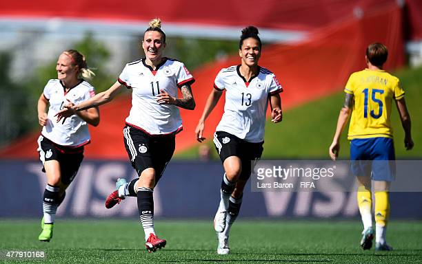Anja Mittag of Germany celebrates after scoring her teams first goal during the FIFA Women's World Cup 2015 Round of 16 match between Germany and...