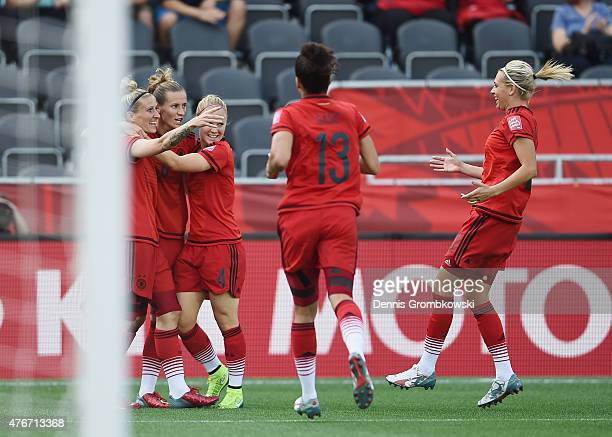 Anja Mittag of Germany celebrates as she scores the opening goal during the FIFA Women's World Cup Canada 2015 Group B match between Germany and...