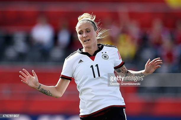 Anja Mittag of Germany celebrates as she scores the sixth goal during the FIFA Women's World Cup Canada 2015 Group B match between Germany and Cote...