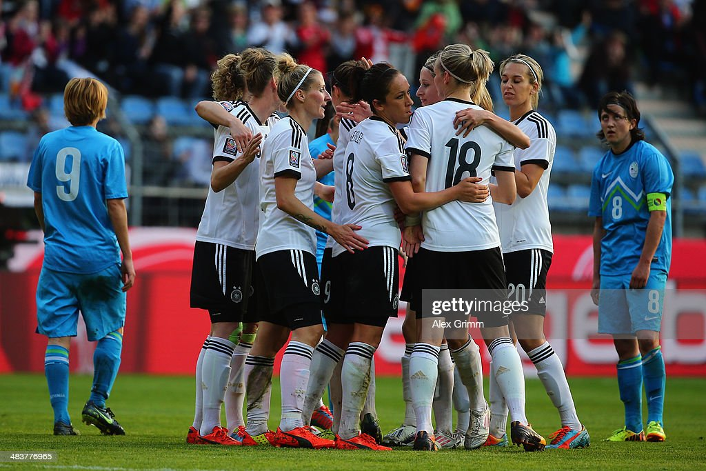 Anja Mittag of Germany celebrates his team's fourth goal with team mates during the FIFA Women's World Cup 2015 qualifying match between Germany and Slovenia at Carl-Benz-Stadion on April 10, 2014 in Mannheim, Germany.