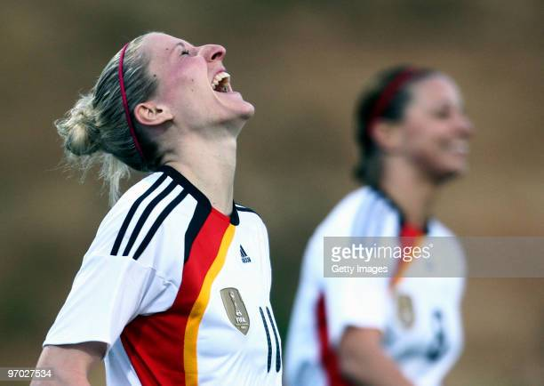 Anja Mittag of Germany celebrates scoring a goal during the Woman's Algarve Cup match between Germany and Denmark at the Estadio da Belavista on...