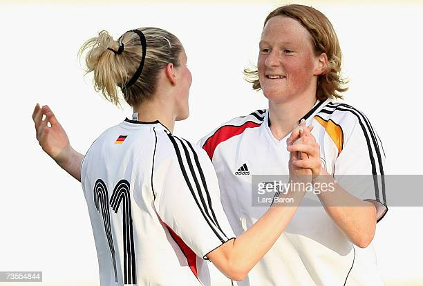 Anja Mittag of Germany celebrates scoring the first goal with team mate Melanie Behringerduring the Algarve Cup match between Germany and Denmark at...