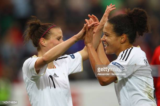 Anja Mittag of Germany celebrates scoring the second goal with her team mate Celia Okoyino da Mbabi during the UEFA Women's EURO Qualifier between...