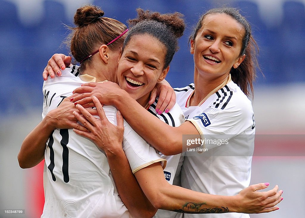 <a gi-track='captionPersonalityLinkClicked' href=/galleries/search?phrase=Anja+Mittag&family=editorial&specificpeople=210615 ng-click='$event.stopPropagation()'>Anja Mittag</a> of Germany celebrates with Celia Okoyino da Mbabi and Fatmire Bajramaj after scoring his teams second goal during the UEFA Womens Euro 2013 qualification match between Germany and Turkey at Schauinsland-Reisen-Arena on September 19, 2012 in Duisburg, Germany.