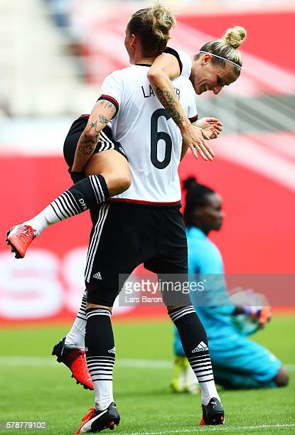 Anja Mittag of Germany celebrates with Simone Laudehr of Germany during the women's international friendly match between Germnay and Ghana at...