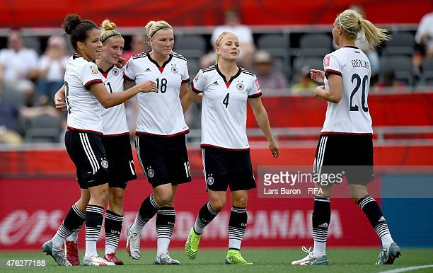 Anja Mittag of Germany celebrates with team amtes after scoring her teams third goal during the FIFA Women's World Cup 2015 Group B match between...