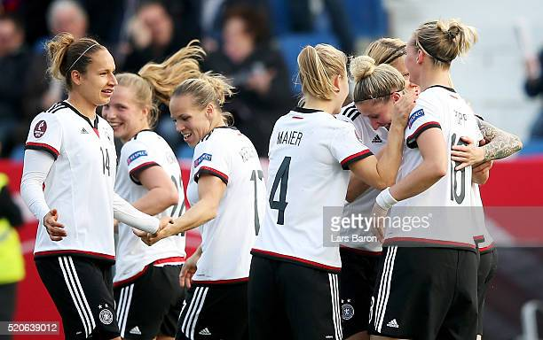 Anja Mittag of Germany celebrates with team mates after scoring her teams second goal during the UEFA Women's Euro 2017 qualifier between Germany and...