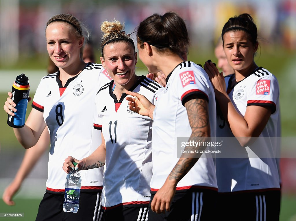 Anja Mittag of Germany celebrates with team mates after the FIFA Women's World Cup Canada 2015 Round of 16 match between Germany and Sweden at Lansdowne Stadium on June 20, 2015 in Ottawa, Canada.