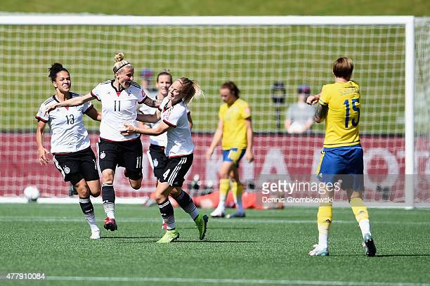 Anja Mittag of Germany celebrates with team mates as she scores the opening goal during the FIFA Women's World Cup Canada 2015 Round of 16 match...