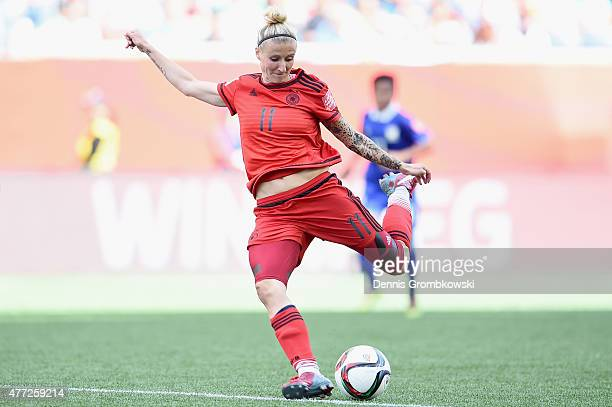 Anja Mittag of Germany controls the ball during the FIFA Women's World Cup Canada 2015 Group B match between Thailand and Germany at Winnipeg Stadium...