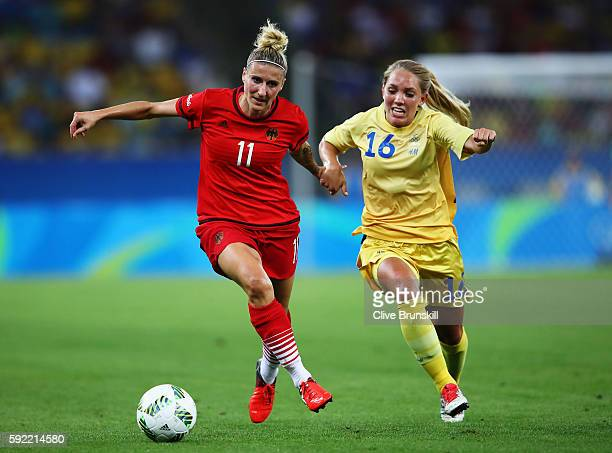 Anja Mittag of Germany holds off the challenge of Elin Rubensson of Sweden during the Women's Olympic Gold Medal match between Sweden and Germany at...