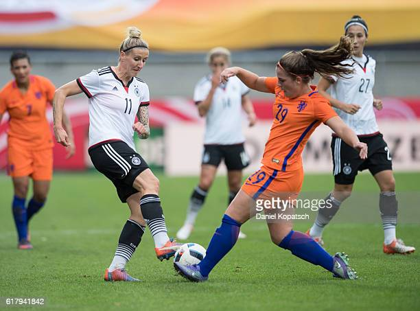 Anja Mittag of Germany is challenged by Siri Worm of the Netherlands during the Women's International Friendly match between Germany and the...
