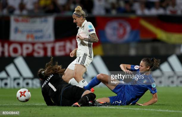 Anja Mittag of Germany is tackled by Laura Giuliani goalkeeper of Italy during the Group B match between Germany and Italy during the UEFA Women's...