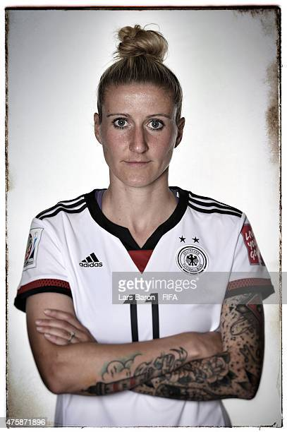 Anja Mittag of Germany poses during the FIFA Women's World Cup 2015 portrait session at Fairmont Chateau Laurier on June 3 2015 in Ottawa Canada