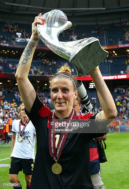 Anja Mittag of Germany poses with the trophy after the UEFA Women's EURO 2013 final match between Germany and Norway at Friends Arena on July 28 2013...