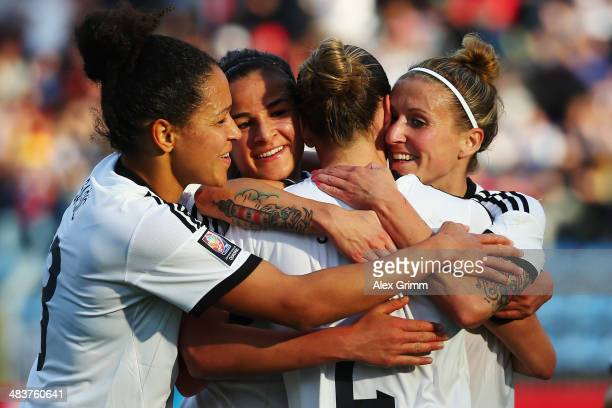 Anja Mittag of Germany scores his team's second goal with team mates Bianca Schmidt Lena Lotzen and Celia Sasic during the FIFA Women's World Cup...