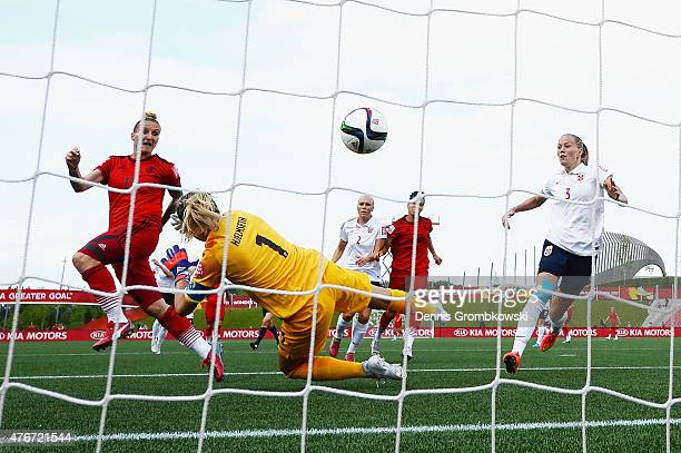 Anja Mittag of Germany scores the opening goal past goalkeeper Ingrid Hjelmseth of Norway during the FIFA Women's World Cup Canada 2015 Group B match...