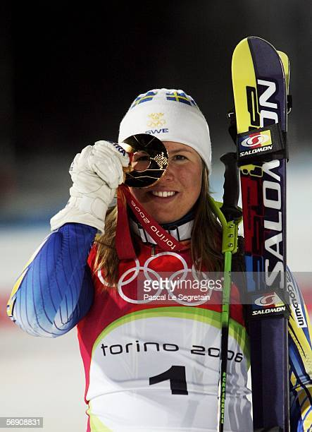 Anja Paerson of Sweden celebrates winning the gold medal in the Womens Alpine Skiing Slalom Final on Day 12 of the 2006 Turin Winter Olympic Games on...