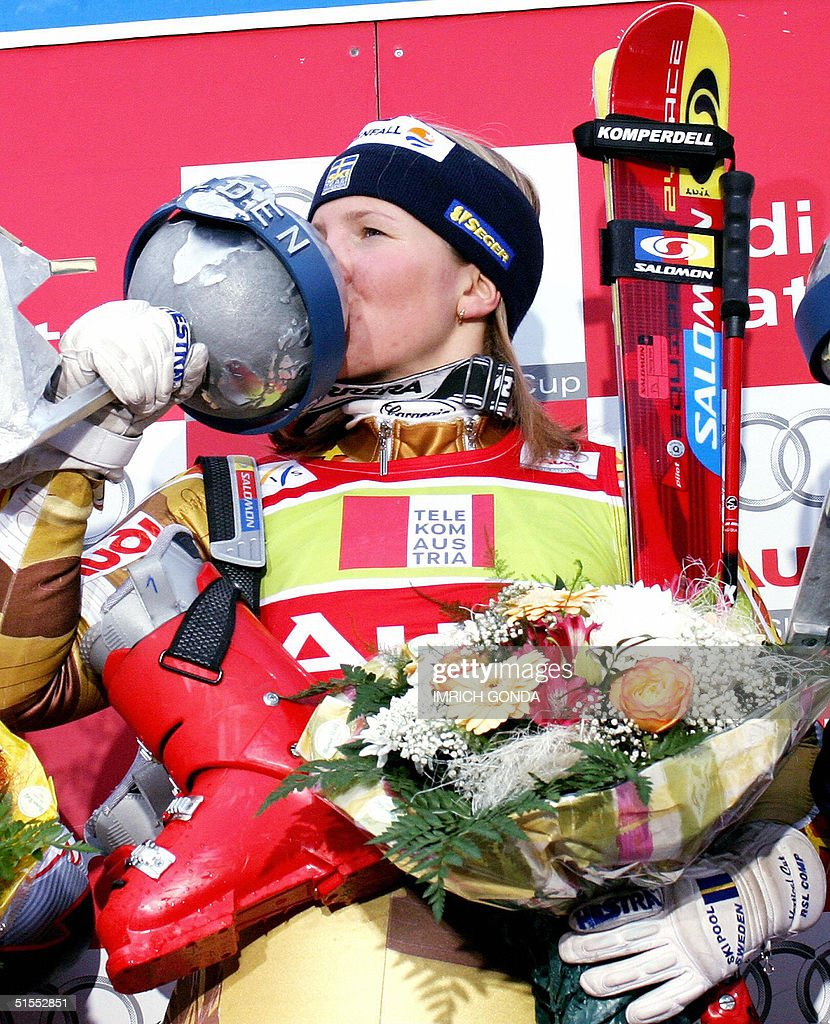 Anja Paerson of Sweden kisses her trophy after winning the season-opening women's World Cup giant slalom in Soelden 23 October 2004. Paerson won ahead of Tanja Poutianen of Finland and Maria Jose Rienda Contreras of Spain.