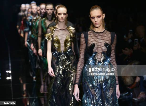 Anja Rubik and models walk the runway at the Gucci fashion show as part of Milan Fashion Week Womenswear Fall/Winter 2013/14 on February 20 2013 in...