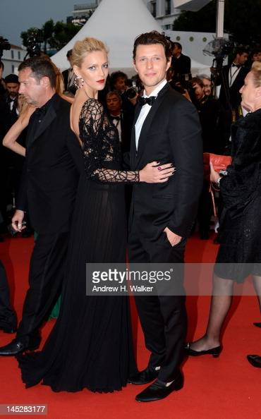 Anja Rubik and Sasha Knezevic attends the 'Cosmopolis' premiere during the 65th Annual Cannes Film Festival at Palais des Festivals on May 25 2012 in...