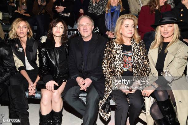 Anja Rubik Charlotte Gainsbourg FrancoisHenri Pinault Catherine Deneuve and Kate Moss attend the Saint Laurent show as part of the Paris Fashion Week...