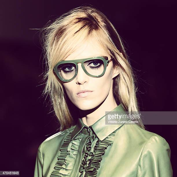 Anja Rubik walks the runway at the Gucci Show during Milan Fashion Week Womenswear Autumn/Winter 2014 on February 19 2014 in Milan Italy