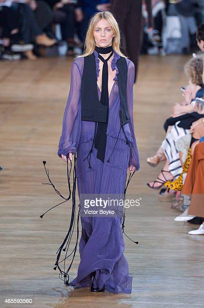 Anja Rubik walks the runway during the Chloe show as part of the Paris Fashion Week Womenswear Fall/Winter 2015/2016 on March 8 2015 in Paris France