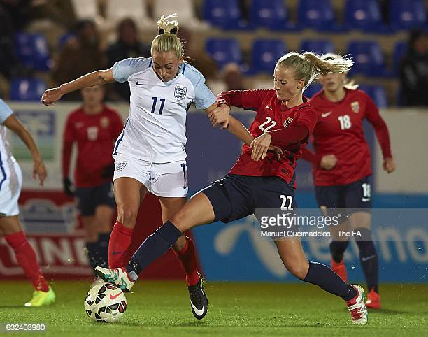 Anja Sonstevold of Norway competes for the ball with Toni Duggan of England during the international friendly match between Norway Women and England...