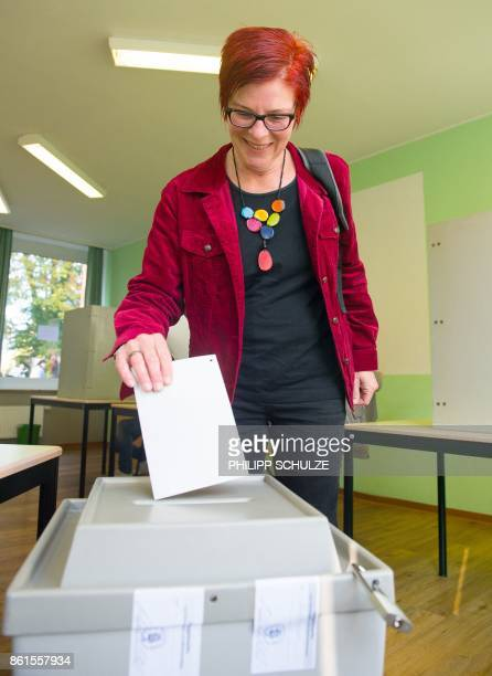 Anja Stoeck top candidate of Germany's left wing Die Linke party for regional elections in Lower Saxony casts her ballot at a polling station in...